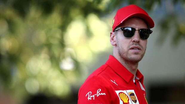 MELBOURNE, AUSTRALIA - MARCH 12: Sebastian Vettel of Germany and Ferrari looks on in the Paddock during previews ahead of the F1 Grand Prix of Australia at Melbourne Grand Prix Circuit on March 12, 2020 in Melbourne, Australia. (Photo by Mark Thompson/Getty Images)