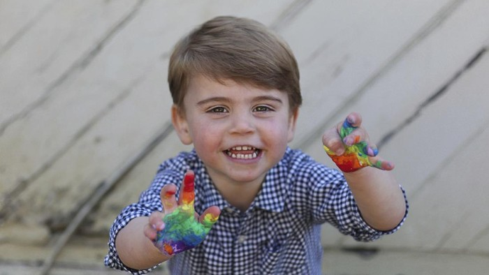 In this undated photo released Wednesday April 22, 2020, by Kensington Palace, showing a rainbow colours painted handprint done by Prince Louis, who celebrates his second birthday Thursday, April 23, 2020, in this photo taken by his mother, Kate the Duchess of Cambridge.  (The Duchess of Cambridge / Kensington Palace via AP)