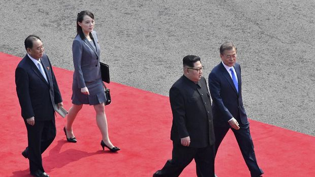 FILE - In this April 27, 2018, file photo, North Korean leader Kim Jong Un, second from right, walks with South Korean President Moon Jae-in, right, to hold their meeting at the border village of Panmunjom in Demilitarized Zone. Second from left is Kim's sister Kim Yo Jong. Kim Jong Un's disappearance from the public eye is raising speculation about not only his health but also about who's next in line to run North Korea if anything happens to the leader. Some experts say his sister and close associate Kim Yo Jong is most likely since North Korea has been ruled by the Kim family for seven decades. (Korea Summit Press Pool via AP, File)