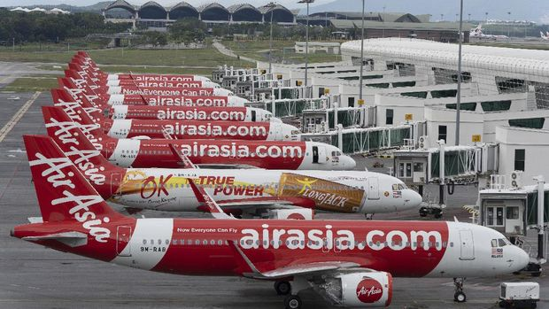 Air Asia planes Airbus A320 parked at tarmac at KLIA2 low cost terminal in Sepang, Malaysia, on Monday, April 27, 2020. AirAsia is on a temporary hibernation to all international and domestic flights due to the ongoing global outbreak of Covid-19. (AP Photo/Vincent Thian)