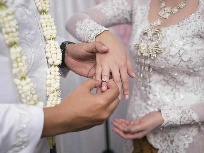 Pasang Cincin on Javanese Wedding. Traditional Javanese Groom Puts a Ring On The Bride