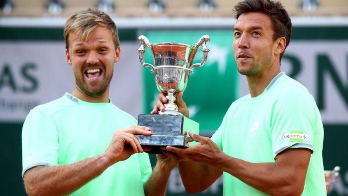 PARIS, FRANCE - JUNE 08: Kevin Krawietz of Germany and partner Andreas Mies of Germany hold the trophy as they celebrate victory during the mens doubles final against Jeremy Chardy of France and Fabrice Martin of France during Day fourteen of the 2019 French Open at Roland Garros on June 08, 2019 in Paris, France. (Photo by Julian Finney/Getty Images)