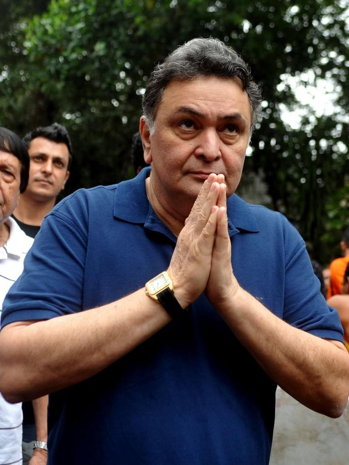 (FILES) In this file photo taken on September 08, 2014 Bollywood actor Rishi Kapoor gestures towards a statue of the elephant-headed Hindu god Lord Ganesh during the Ganesh Charturthi festival in Mumbai. - Bollywood mourned its second loss in as many days as celebrated actor Rishi Kapoor, whose career spanned half a century, died April 30, 2020, aged 67 after a prolonged struggle with cancer. His death came as a severe blow to the Hindi movie industry and film lovers, who were already reeling from the death of Irrfan Khan, one of the countrys most feted actors, on April 29 aged just 53. (Photo by - / AFP)