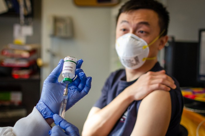 Illustrative picture of Chinese male getting vaccinated against coronavirus