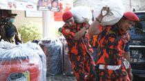 Distribusi Bantuan untuk Relawan COVID-19