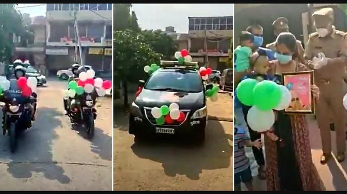 Polisi India melakukan konvoi perayaan ultah bayi