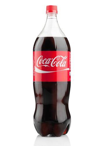 Bentuk botol minuman soda dengan lima tonjolan kaki di bawahnya.