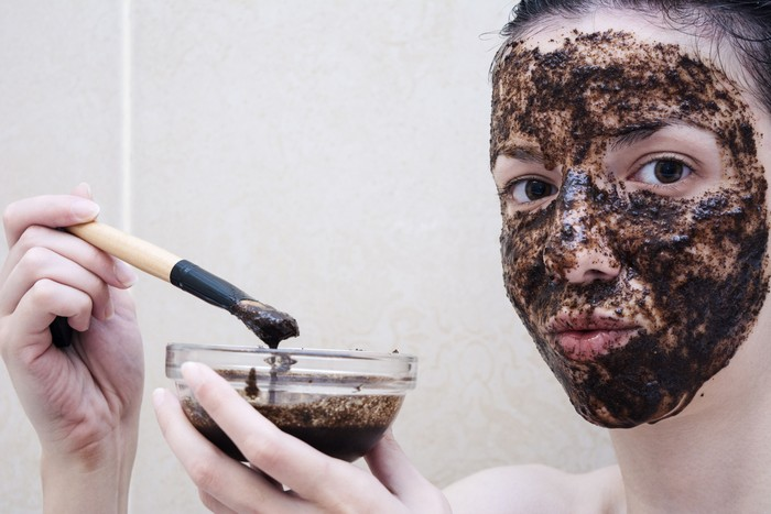 Caucasian model, age 20-29 years old using a face scrub made out of coffee, honey and milk