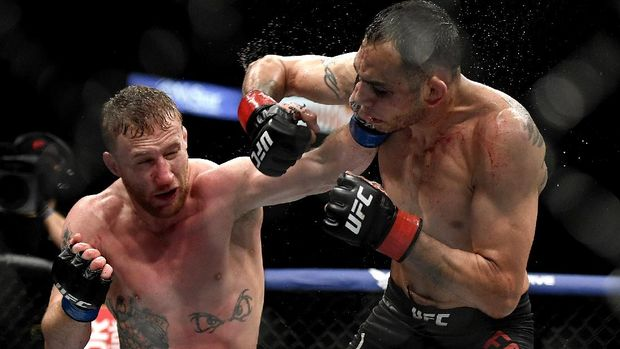 JACKSONVILLE, FLORIDA - MAY 09: Justin Gaethje (L) of the United States punches Tony Ferguson (R) of the United States in their Interim lightweight title fight during UFC 249 at VyStar Veterans Memorial Arena on May 09, 2020 in Jacksonville, Florida.   Douglas P. DeFelice/Getty Images/AFP