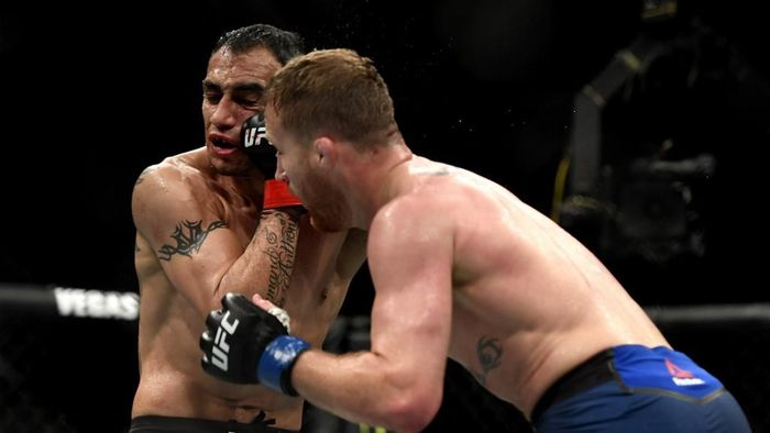 JACKSONVILLE, FLORIDA - MAY 09: Justin Gaethje (R) of the United States punches Tony Ferguson (L) of the United States in their Interim lightweight title fight during UFC 249 at VyStar Veterans Memorial Arena on May 09, 2020 in Jacksonville, Florida.   Douglas P. DeFelice/Getty Images/AFP