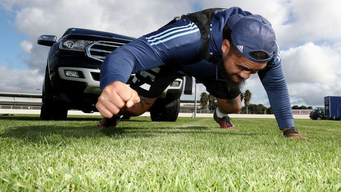 AUCKLAND, NEW ZEALAND - MAY 07: All Black and Blues prop Ofa Tuungafasi pulls his SUV in a harness as he uses it in place of a scrum machine while he trains in isolation at the Blues HQ at Alexandra Park due to the coronavirus lockdown on May 07, 2020 in Auckland, New Zealand. New Zealand has been in lockdown since Thursday 26 March following tough restrictions imposed by the government to stop the spread of COVID-19 across the country.  (Photo by Phil Walter/Getty Images)