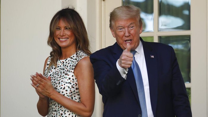President Donald Trump gives a thumbs up as he and first lady Melania Trump leave after a presidential recognition ceremony in the Rose Garden of the White House, Friday, May 15, 2020, in Washington. (AP Photo/Alex Brandon)