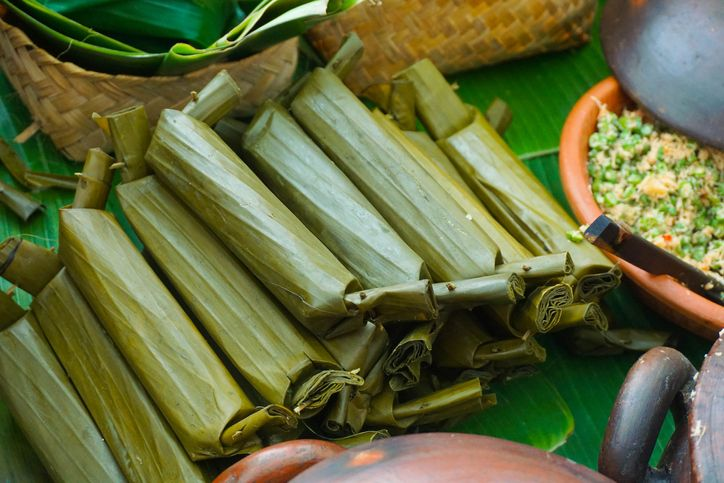 Lontong, a traditional dish in Malaysia and indonesia during Eid. The rice cooked and boiled inside the banana leaf wrap.