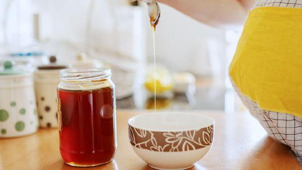 Ilustrasi ibu hamil konsumsi madu