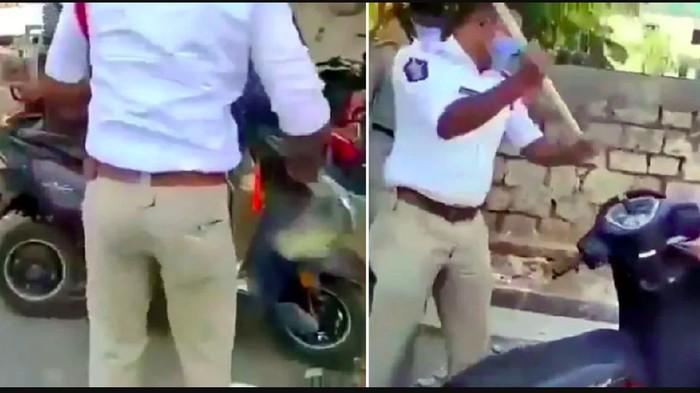 Polisi Pukuli Motor Pelanggar Lockdown