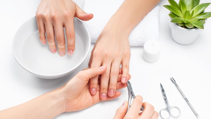 Hands care in the spa. Beautiful womans hands with perfect manicure. Manicurist master makes manicure