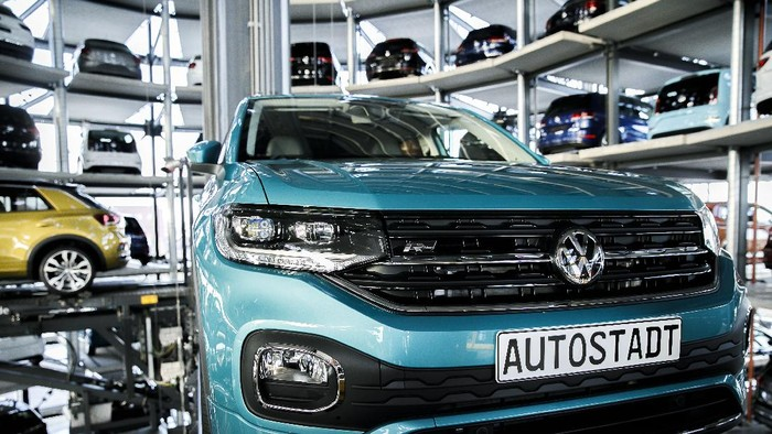 WOLFSBURG, GERMANY - DECEMBER 04: A Volkswagen t-roc is presented in one of the twin car towers at the Volkswagen Autostadt visitors center on December 4, 2018 in Wolfsburg, Germany. Volkswagen, Germanys biggest carmaker, has been embroiled in a costly emissions scandal after it installed illegal software in millions of its cars. The car giant announced recently that the company will face a difficult year in 2019 due to ongoing court cases stemming from the software, designed to manipulate emissions in diesel cars, which has so far cost the company EUR 28 billion in fines and costs. (Photo by Carsten Koall/Getty Images)