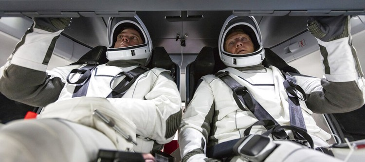 In this Jan. 17, 2020 photo made available by SpaceX, NASA astronauts Bob Behnken, left, and Doug Hurley, wearing SpaceX spacesuits, walk through the Crew Access Arm connecting the launch tower to the SpaceX Crew Dragon spacecraft during a dress rehearsal at NASAs Kennedy Space Center in Cape Canaveral, Fla. For their May 27, 2020 mission, Hurley will be in charge of launch and landing and Behnken will oversee rendezvous and docking at the International Space Station. (SpaceX via AP)