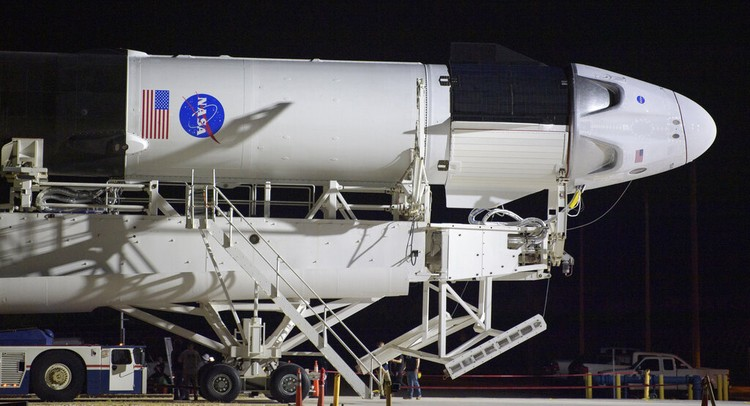 A SpaceX Falcon 9 rocket with the companys Crew Dragon spacecraft is rolled out of the horizontal integration facility at Launch Complex 39A as preparations continue for the Demo-2 mission, Thursday, May 21, 2020, at NASAs Kennedy Space Center in Cape Canaveral, Fla. (Bill Ingalls/NASA via AP)
