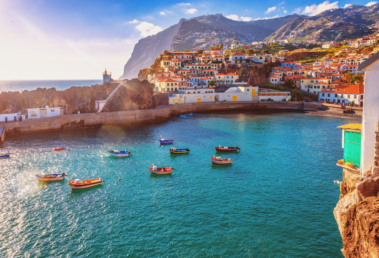 The beautiful fishing village of Camara de Lobos on the portugese Island of Madeira in warm evening sunshine light.