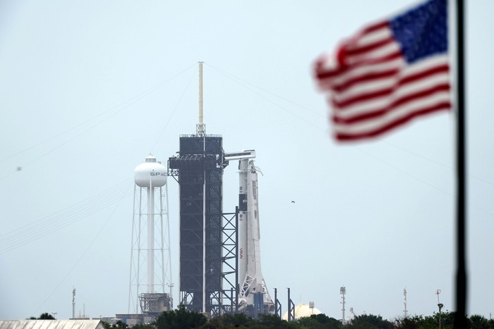 The SpaceX Falcon 9, with the Crew Dragon spacecraft on top of the rocket, sits on Launch Pad 39-A Sunday, May 24, 2020, at Kennedy Space Center, in Fla. Two astronauts will fly on the SpaceX Demo-2 mission to the International Space Station scheduled for launch on May 27. (AP Photo/Chris O'Meara)