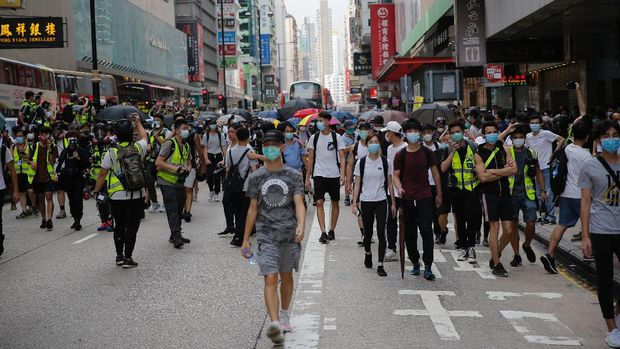 Protesters set up a roadblock on a main road in the Mongkok district as a second reading of a controversial national anthem law takes place in Hong Kong, Wednesday, May 27, 2020. Hong Kong police massed outside the legislature complex Wednesday, ahead of debate on a bill that would criminalize abuse of the Chinese national anthem in the semi-autonomous city. (AP Photo/Kin Cheung)