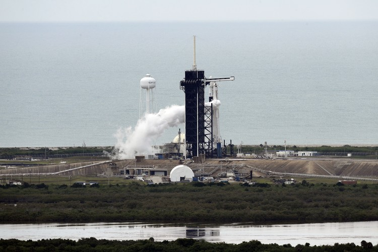 A NASA helicopter escorts the crew to Launch Pad 39-A, Wednesday, May 27, 2020, at Kennedy Space Center in Cape Canaveral, Fla. Two astronauts will fly on the SpaceX Demo-2 mission to the International Space Station scheduled for launch Wednesday. (AP Photo/David J. Phillip)