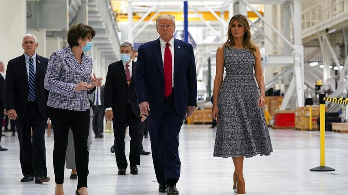 President Donald Trump and first lady Melania Trump participate in a tour of NASA facilities before viewing the SpaceX Demonstration Mission 2 Launch at Kennedy Space Center, Wednesday, May 27, 2020, in Cape Canaveral, Fla. Vice President Mike Pence, left, and Marillyn Hewson, chief executive officer of Lockheed Martin, second from left. (AP Photo/Evan Vucci)
