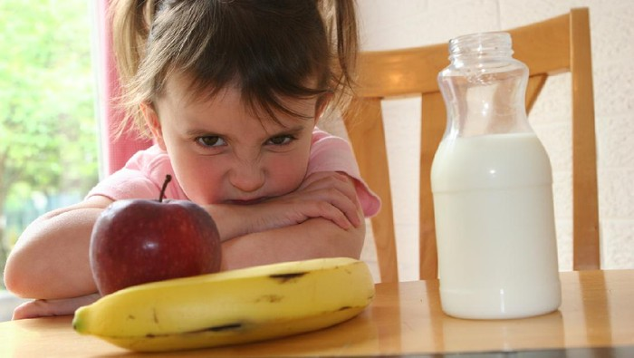 Little Girl refusing to eat healthy lunch/snack of fruit and drink her milk