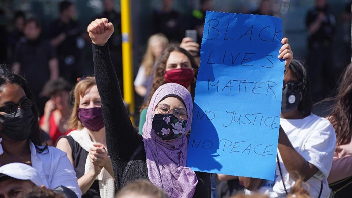 BERLIN, GERMANY  - MAY 31: A Muslim woman wears a face mask that reads: