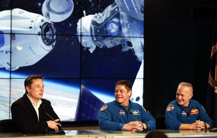Vice President Mike Pence, his wife Karen, right, NASA administrator, Jim Bridenstine, center and CEO of SpaceX, Elon Musk, talk to the media after NASA astronauts Douglas Hurley and Robert Behnken left the Neil A. Armstrong Operations and Checkout Building on their way to Pad 39-A, at the Kennedy Space Center in Cape Canaveral, Fla., Wednesday, May 27, 2020. The two astronauts will fly on a SpaceX test flight to the International Space Station. For the first time in nearly a decade, astronauts will blast into orbit aboard an American rocket from American soil, a first for a private company. (AP Photo/John Raoux)