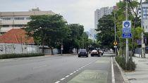 Rambu Wajib Pakai Masker Bermunculan di Jalanan Kota Surabaya