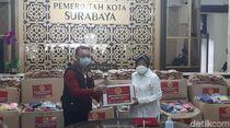 Selain Mobil PCR, Surabaya Juga Dapat Bantuan 120.000 Masker dari BIN