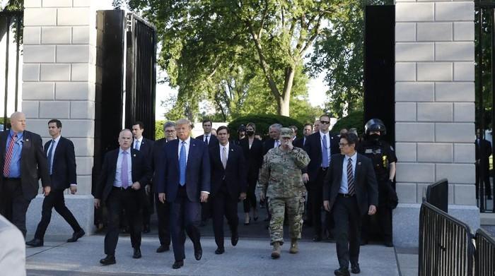 President Donald Trump walks from the gates of the White House to visit St. Johns Church across Lafayette Park Monday, June 1, 2020, in Washington. (AP Photo/Patrick Semansky)