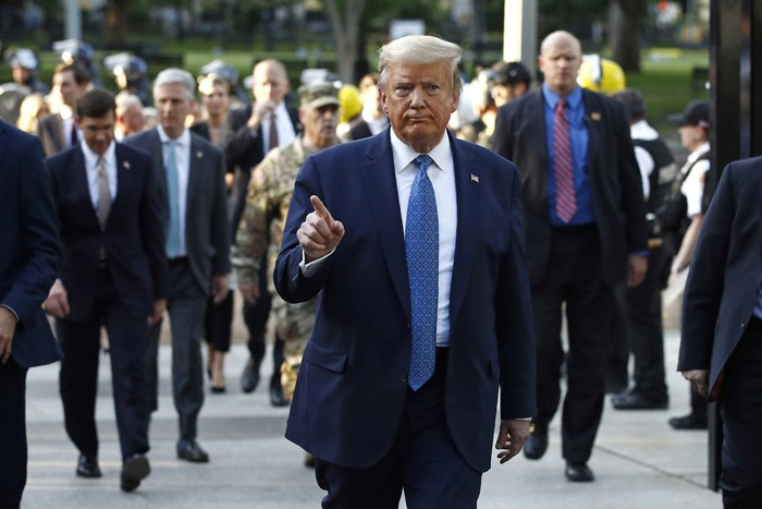 President Donald Trump returns to the White House after visiting outside St. Johns Church, Monday, June 1, 2020, in Washington. Part of the church was set on fire during protests on Sunday night. (AP Photo/Patrick Semansky)