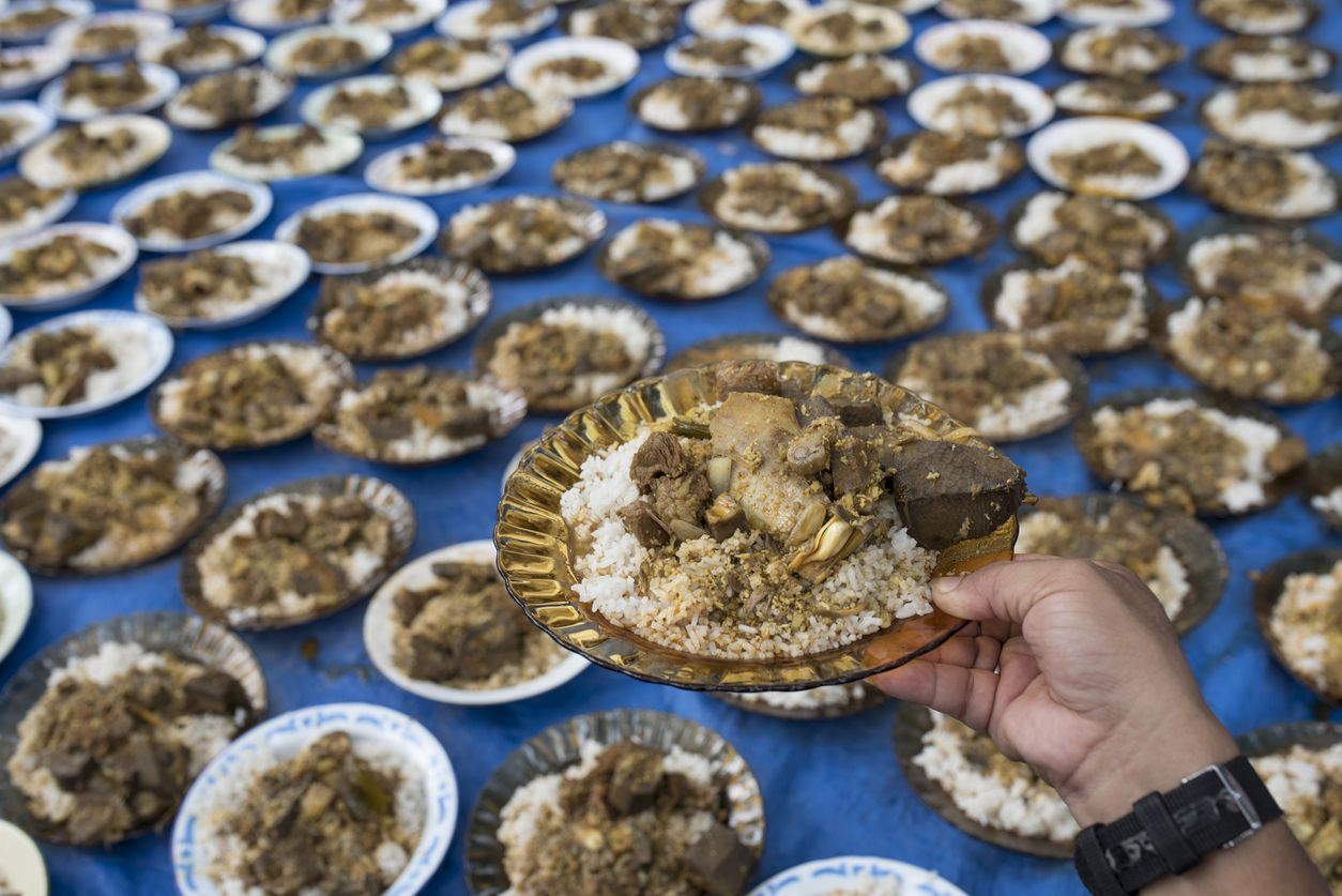 Traditional Aceh Food 'Kuah Beulangong' / traditional Acehnese cuisine made from meat mixed with jackfruit and eaten with white rice