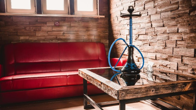 Cozy room with bright sun from the window and furniture - hookah room