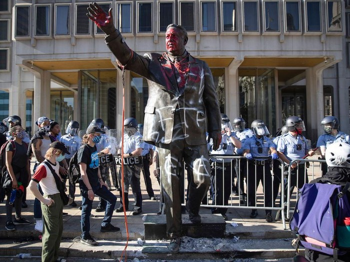 Mandatory Credit: Photo by Matt Rourke/AP/Shutterstock (10668116a) Police stand near a vandalized statue of controversial former Philadelphia Mayor Frank Rizzo in Philadelphia, during protests over the death of George Floyd, who died May 25 after he was restrained by Minneapolis police. Workers early Wednesday, June 3 removed the statue which was recently defaced during the weekend protest Mayor Statue-Removed, Philadelphia, United States - 30 May 2020