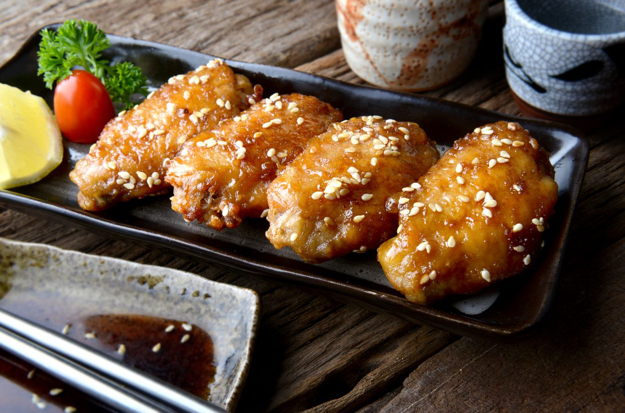 Fried chicken wing with spicy sauce in Japanese style or Tebasaki wing serve in izakaya restourant.