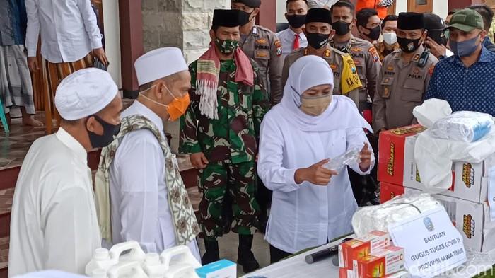 Forkopimda Ngawi membuka posko Kampung Tangguh penanggulangan COVID-19. Kampung Tangguh yang didirikan Polres Ngawi juga menjamin ketersediaan lumbung pangan.