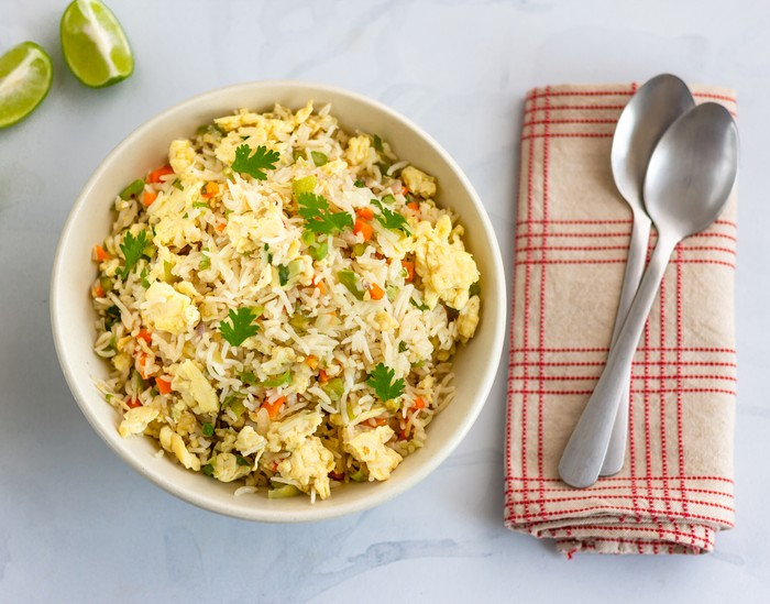 Egg Fried Rice with Vegetables in a Bowl - Directly from Above. Chinese Fried Rice, Chinese Cuisine, Comfort Food Concept.