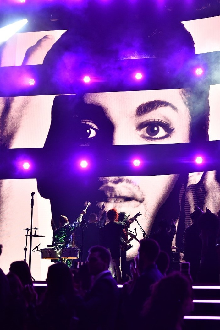 LOS ANGELES, CALIFORNIA - JANUARY 26: An image of the late Prince is projected on a screen while Usher, Sheila E. and FKA Twigs perform onstage during the 62nd Annual GRAMMY Awards at STAPLES Center on January 26, 2020 in Los Angeles, California.   Emma McIntyre/Getty Images for The Recording Academy/AFP