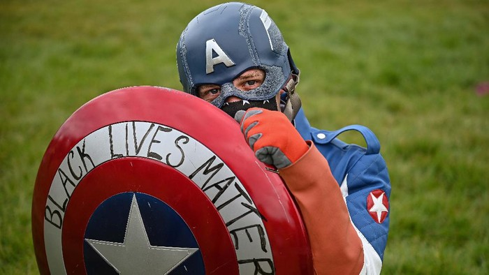 EDINBURGH, SCOTLAND - JUNE 07: A protester dressed as Captain America during a Black Lives Matter protest in Holyrood Park, despite a call by First Minister, Nicola Sturgeon and others to find other forms of protest because of lockdown rules and coronavirus fears on June 7, 2020 in Edinburgh, Scotland.The death of an African-American man, George Floyd, while in the custody of Minneapolis police has sparked protests across the United States, as well as demonstrations of solidarity in many countries around the world. (Photo by Jeff J Mitchell/Getty Images)