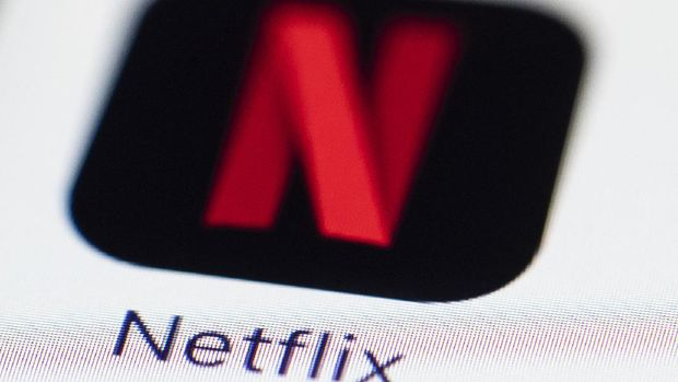 This July 17, 2017, photo shows a Netflix logo on an iPhone in Philadelphia. (AP Photo/Matt Rourke)