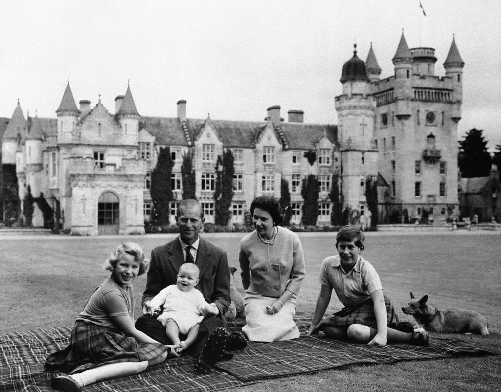 FILE - In this Sept. 1960 file photo, Britain's Queen Elizabeth II, Prince Philip and their children, Prince Charles, right, Princess Anne and Prince Andrew, pose for a photo on the lawn of Balmoral Castle, in Scotland. (AP Photo/File)