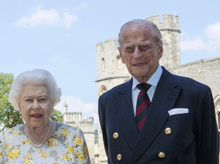 Britains Queen Elizabeth II and Prince Philip the Duke of Edinburgh pose for a photo June 1, 2020, in the quadrangle of Windsor Castle, in Windsor, England, ahead of his 99th birthday on Wednesday, June 10. The Queen is wearing an Angela Kelly dress with the Cullinan V diamond brooch, while Prince Philip is wearing a Household Division tie. (Steve Parsons/Pool via AP)