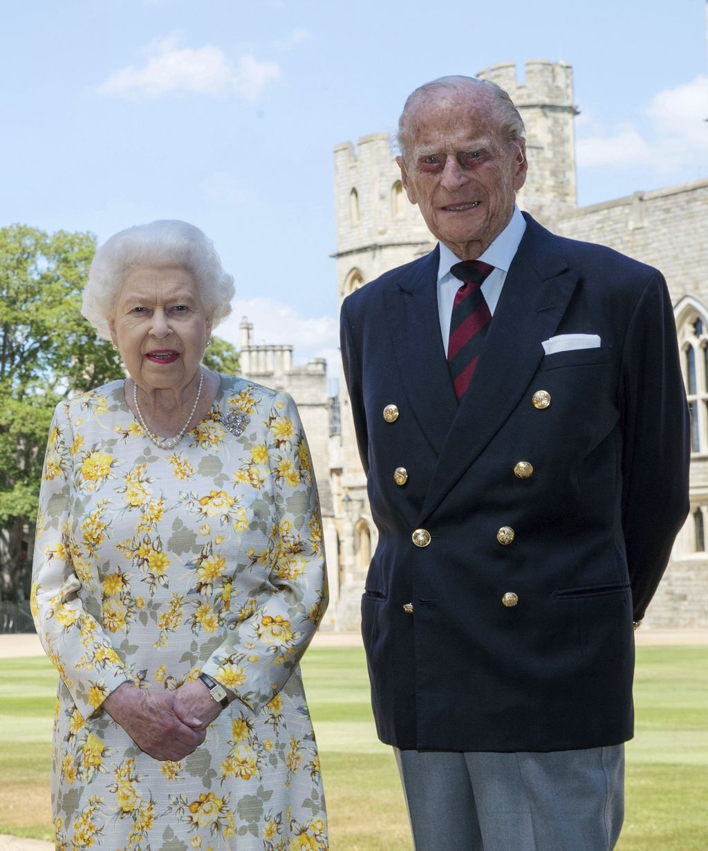 Britain's Queen Elizabeth II and Prince Philip the Duke of Edinburgh pose for a photo June 1, 2020, in the quadrangle of Windsor Castle, in Windsor, England, ahead of his 99th birthday on Wednesday, June 10. The Queen is wearing an Angela Kelly dress with the Cullinan V diamond brooch, while Prince Philip is wearing a Household Division tie. (Steve Parsons/Pool via AP)