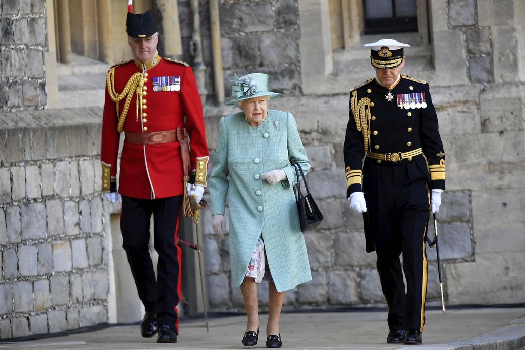 Britain's Queen Elizabeth II looks out during a ceremony to mark her official birthday at Windsor Castle in Windsor, England, Saturday June 13, 2020. Queen Elizabeth II's birthday is being marked with a special ceremony taking care for social distancing by everyone present amid the coronavirus pandemic. The Queen celebrates her 94th birthday this year. (Paul Edwards/Pool via AP)