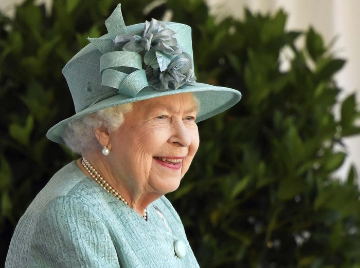 Britains Queen Elizabeth II looks out during a ceremony to mark her official birthday at Windsor Castle in Windsor, England, Saturday June 13, 2020. Queen Elizabeth II's birthday is being marked with a special ceremony taking care for social distancing by everyone present amid the coronavirus pandemic. The Queen celebrates her 94th birthday this year. (Paul Edwards/Pool via AP)