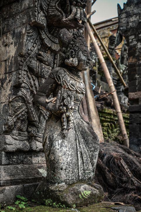Sculpture of woman in Pura Dalem Segara Madhu, Balinese Hindu temple in northern Bali, Indonesia.